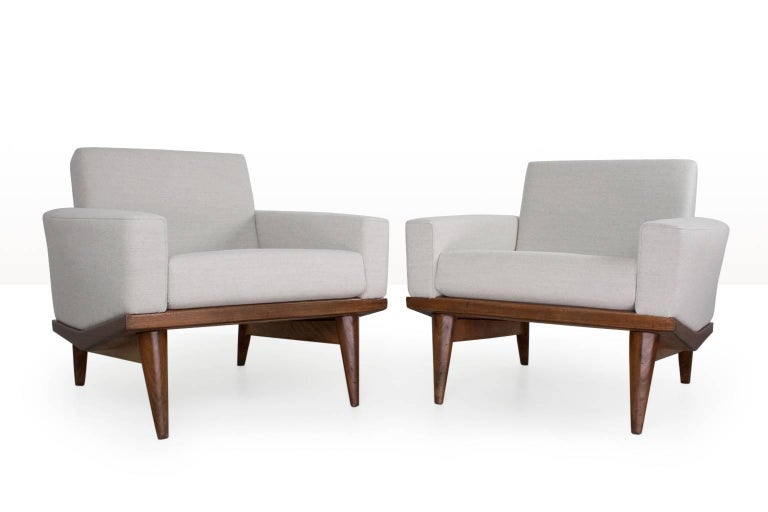 Pair of rare Illum WIkkelso lounge chairs, new upholstered in a excellent quality light grey Ploegwool (no.98) on a teak wooden frame. In excellent condition. The design is often referred to as the 'Australia' design. The sharp finishes of the