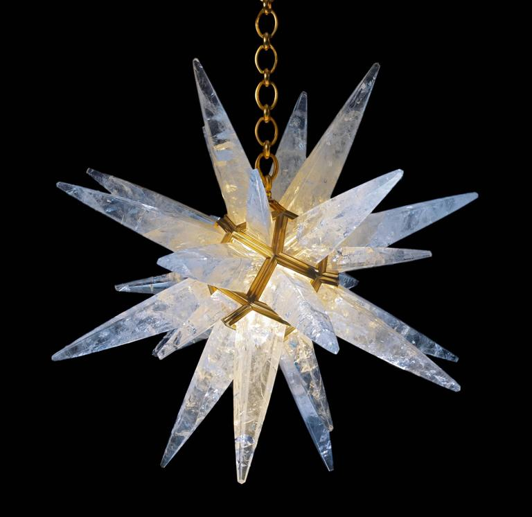 Rock crystal quartz star light gold edition. Since 2011 Alexandre Vossion was the first who made this model only in rock crystal after an Art Deco model. (Which is made only in glass). This rock crystal star lighting is made in France. The fixture,