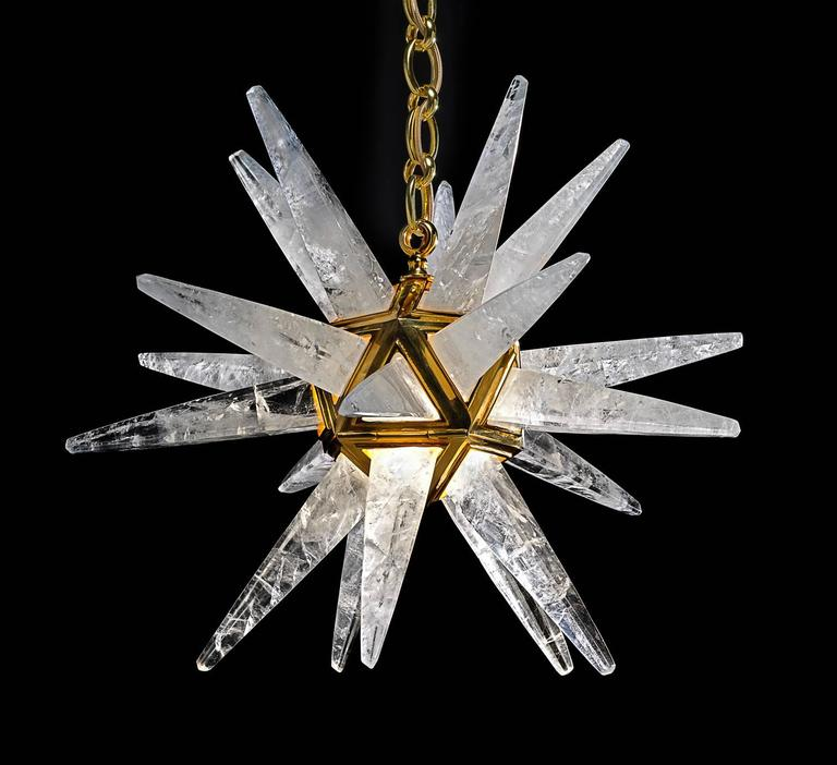 Rock crystal  quartz star III light gold edition. The fixture, the chain and the canopy of this rock crystal lighting are handmade in bronze. Each workers who belongs from a corporation made their work in the pure tradition of the 18th century. All