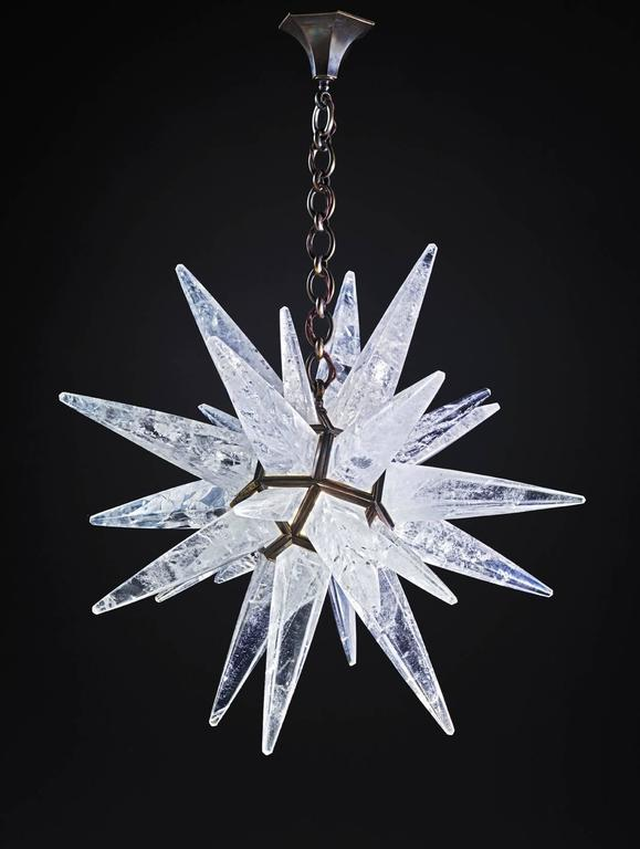 Rock crystal quartz star I light antique brass edition. This patina is made by qualified worker with acids which are burn to a fire, so this color come into the bronze of the fixture for ever and make a patina like a bronze sculpture. Since 2011