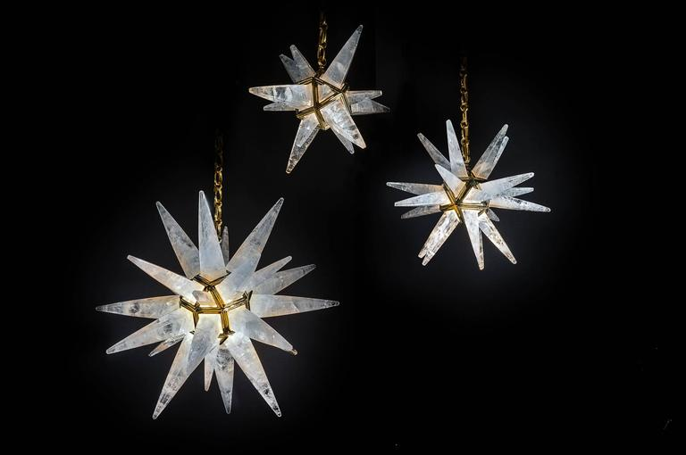 Since 2011 Alexandre Vossion was the first who made this model only in rock crystal after an Art Deco model. (Which is made only in glass). This rock crystal quartz star lighting is made in France. Rock crystal star light gold edition. On this