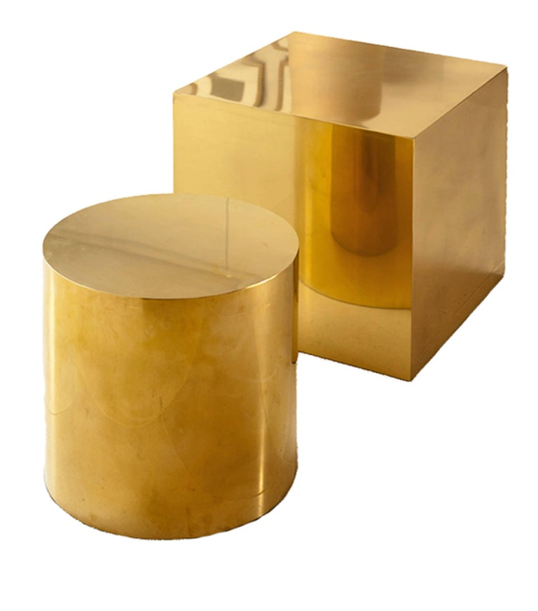 Seamless cube side table. Available in polished brass, antique brass or bronzed finish. Lacquered. Comes on a plinth and a glass top on request. Bespoke dimensions and finishes available on request.   W60 x D60 x H60 cm  Lead time: 10 - 14 weeks