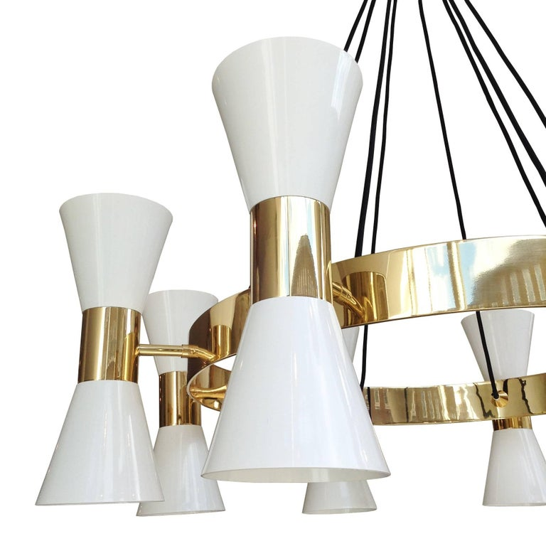 Polished brass chandelier with 8 enamel shades available in either black or white finish and an adjustable 2 meter long cord. Also available in chrome finish. Bespoke finishes available on request.  D60 x H30 cm  6 - 8 weeks lead time
