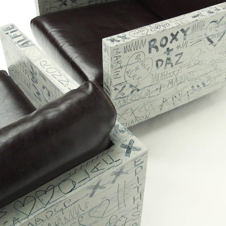 Pair of lounge chairs finished in a free-form hand-painted sweetheart graffiti design by Alan Fears.
