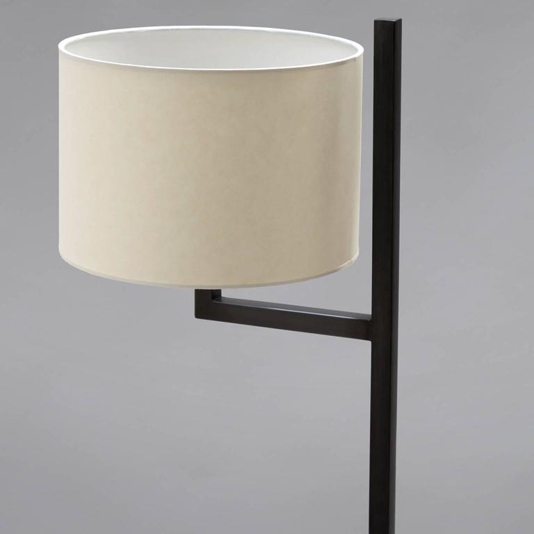 """Cuatro blackened steel floor lamp. 57"""" H x 14"""" D base, 7"""" W arm. Vellum shade included by trans-LUXE Shade measures: 10"""" W x 10"""" W x 7"""" H.  Made in New York City by trans-LUXE Additional custom sizes, colors and finishes available upon"""