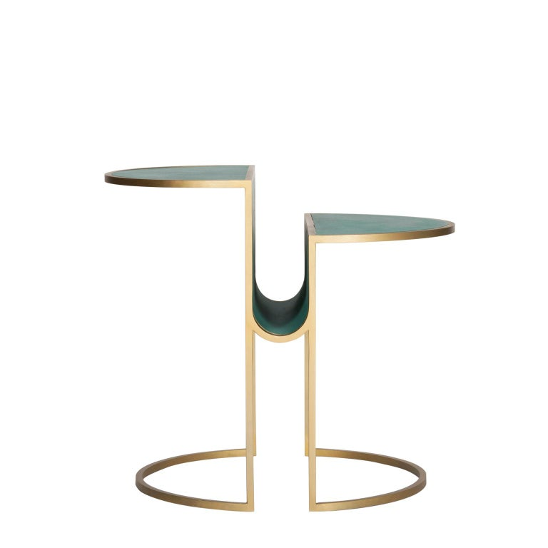 The Orbit tea table is constructed from two semi discs, separated by an eye-catching circular fold, useful to stack magazines. Constructed from thin square rods, the table is elegant, modern, minimal and delicate. The table legs contrast with the