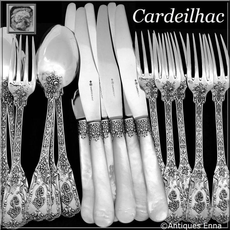 Fabulous French sterling silver dinner flatware set 18 pieces including six dinner spoons, six dinner forks and six matching dinner knife. In the neoclassical pattern, with sumptuous decoration: ribbons, garlands of flowers and foliage. Knives with