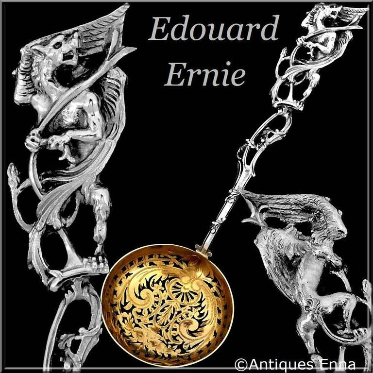 Ernie masterpiece French sterling silver 18-karat gold sugar sifter spoon dragon  Masterpiece by the prestigious silversmith Ernie with a circular pierced bowl, the silver-gilt inside the bowl, the pierced stem and handle with naturalistic