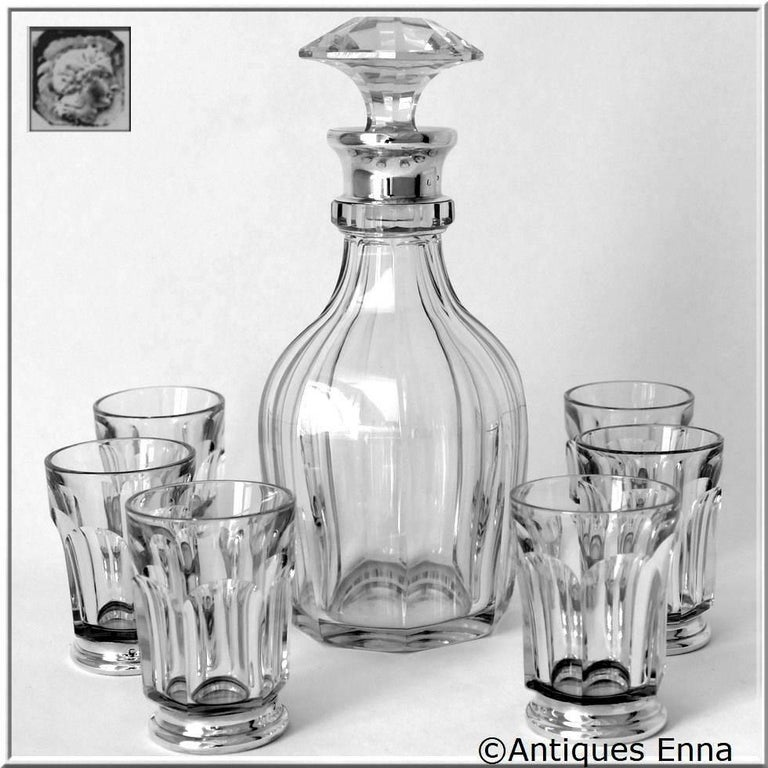 Head of Minerve 1st titre for 950/1000 French sterling silver guarantee.  The set includes six glasses in sterling silver and Baccarat cut crystal and a whiskey or aperitif decanter in sterling silver and Baccarat cut crystal.  These pieces are