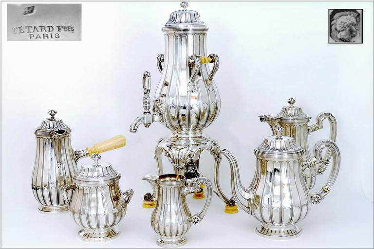 Head of Minerve 1st titre for 950/1000 French Sterling Silver guarantee.   A rare Tetard tea service of seven pieces in all sterling silver. Fabulous neoclassical pattern with a frieze of laurels.  The set includes a hot water urn/samovar with its
