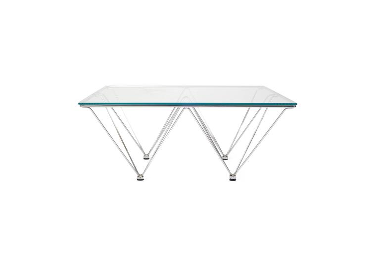 Paolo Piva style coffee table with new glass top. Sculptural chrome base has slight wear.