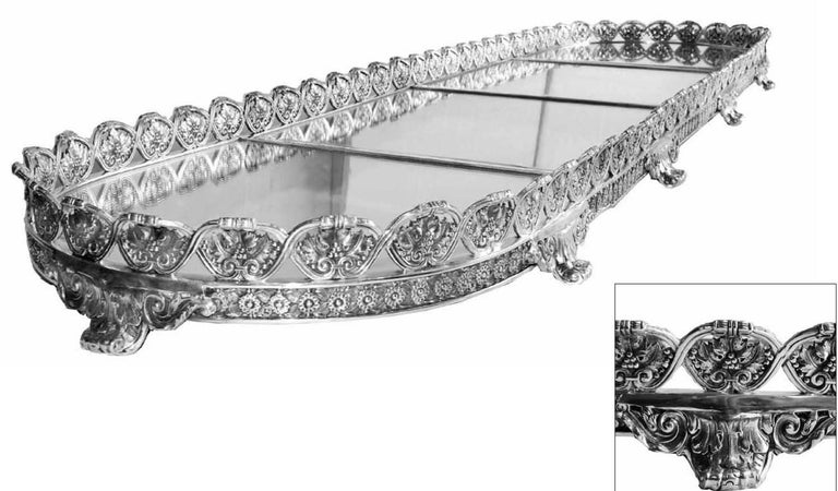 A highly decorative four-section silver plated plateau. Each section is approximate 16 1/4