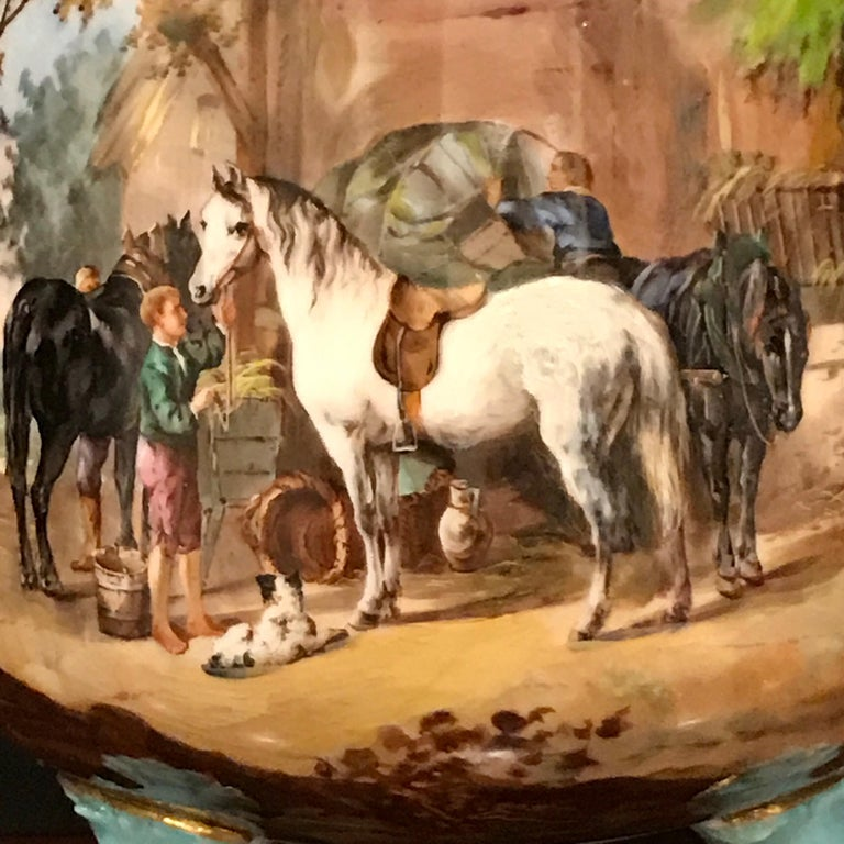 Exquisite Mintons (attributed) Barnyard motif cachepot, beautifully painted with a highly detailed barn interior, with horses, stablemen and a seated dog. Raised on three turquoise and gilt paw feet, Unsigned and Unmarked. The interior measures 8