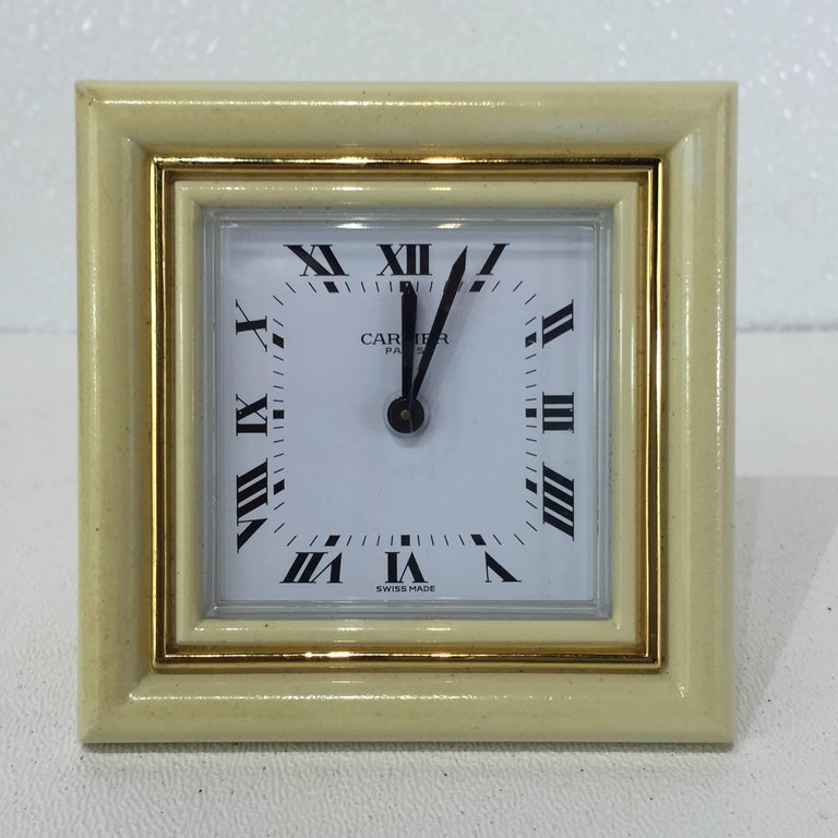 Gilt bronze and enamel Cartier clock, case stamped in script