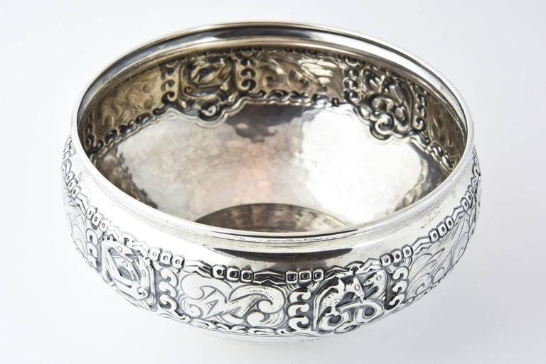 Thune silversmith, famous in Norway since 1857, designed this piece in the early 20th century. The banner displays a Nordic theme of birds, wind and lightning.  Marked Thune 830.   Also present is a dedication that reads: