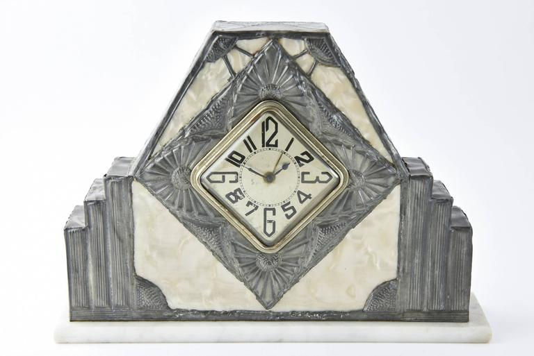 """Tall 6 1/8"""" tall by 8.75"""" wide by 2"""" deep Clock on marble base. Hand engraved pewter over pearlized celluloid.   Vases hand engraved pewter over frosted glass. 4"""" wide by 11 1/8"""" tall 4"""" deep."""