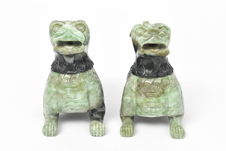 Bi-color green hardstone carved to represent a pair of traditional Chinese foo dogs and lions. The heads of these impressive creatures come off so they can be used as incense burners.