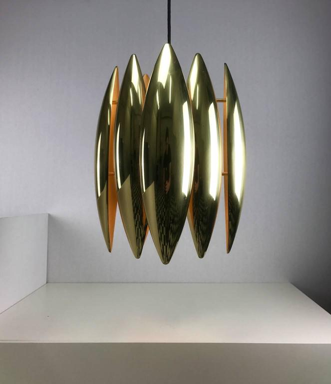 Beautiful brass Kastor ceiling light by Fog & Morup, Denmark, 1969.  Jo Hammerborg designed this amazing piece of danish design which has become one of this decades most iconic lighting fixtures.  Condition: Close to mint condition.  Light