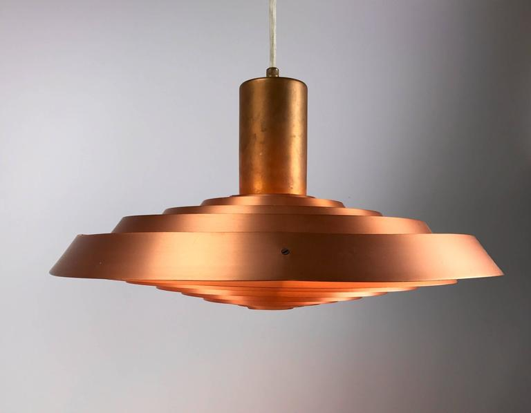 Deisgned by Poul Henningsen in 1958 for the restaurant Langelinie Pavillonen in Copenhagen. The restaurant is situated by the seaside which gave him the inspiration of watercircles. 