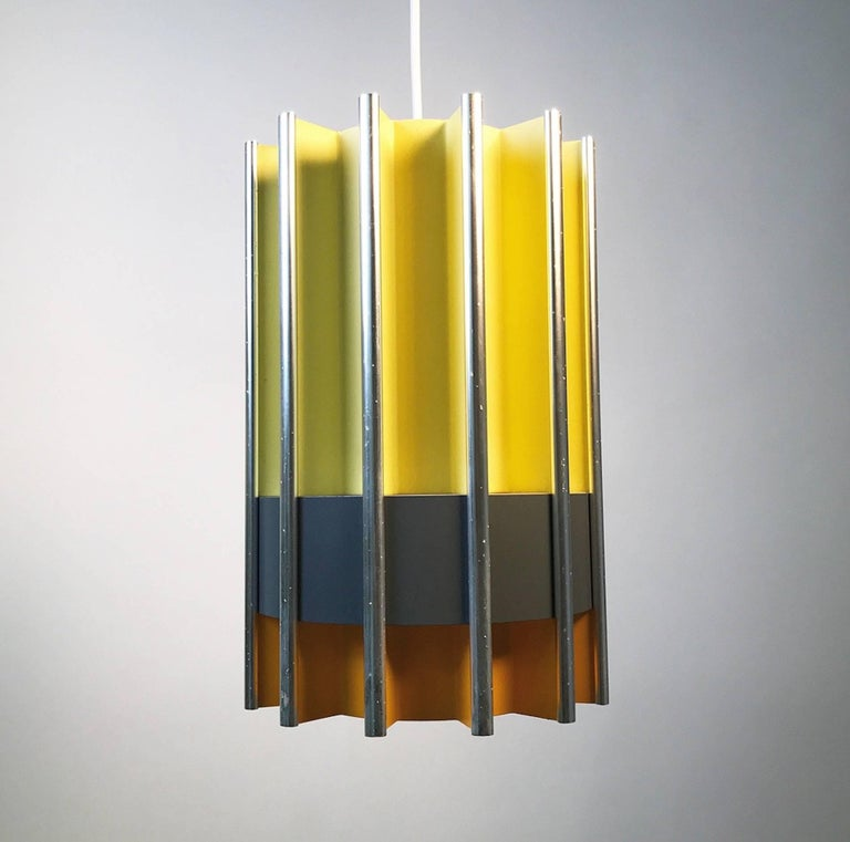 The rare Pantre by Bent Karlby for Lyfa, mid-1960s, Denmark.   Sections of orange and yellow lacquered parts divided with a grey belt of lighting shining through the sides. Light is also distributed up and down wards.  All the pieces are put