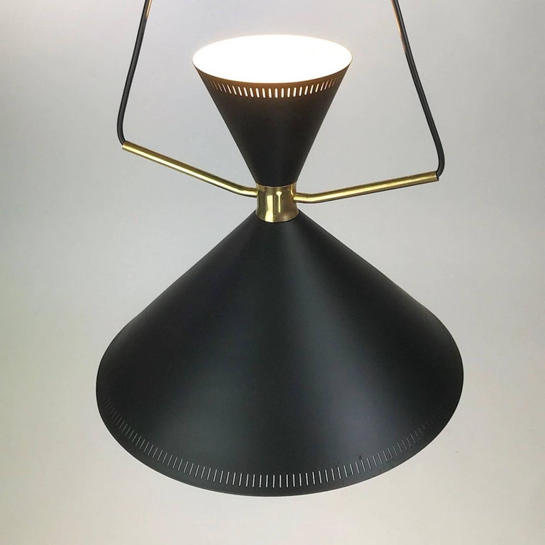 Are you looking for a beautiful and extremely rare Mid-Century Modern light for you home, this is going to be the eye catcher you are looking for.