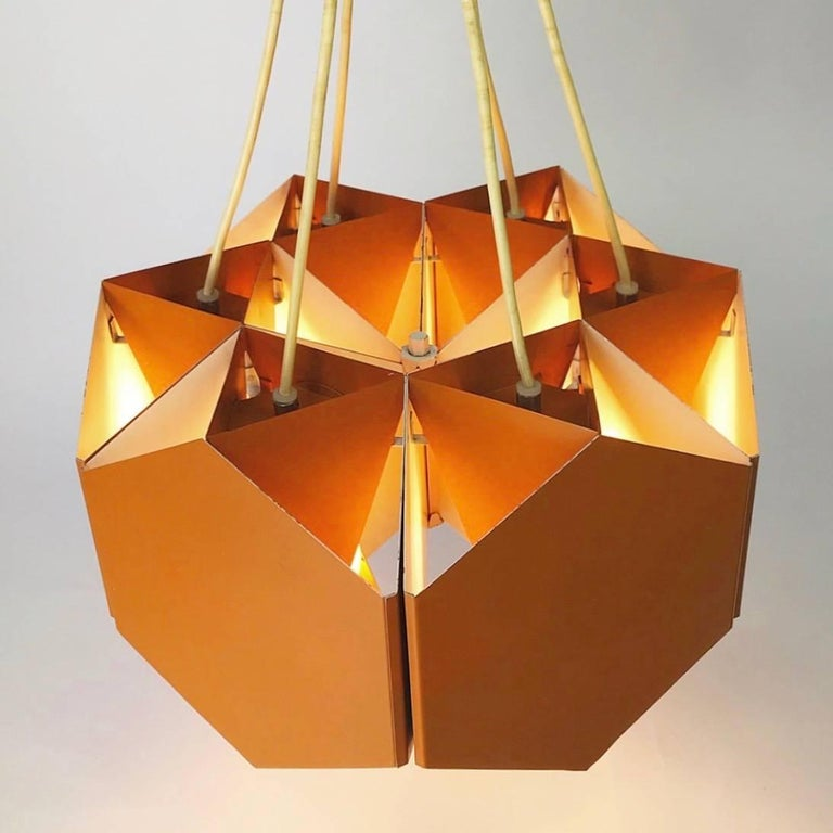 """Great lighting design - like this astonishing masterpiece - is contemporary, functional and an eye-catcher.  The """"3/6"""" light combines all of these and then some.  The chandelier consists of six single pendants made of triangular metal with"""