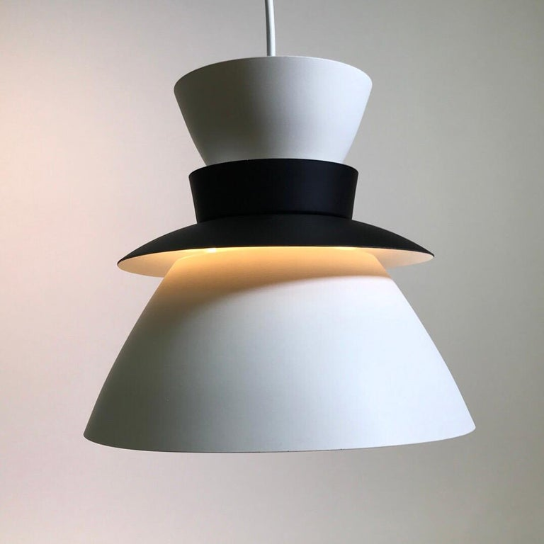 Renowned architect and designer Jorn Utzon, Denmark designed this beautiful ceiling pendant for Artek Finland in 1957.   At the same time he was deeply involved with the design of the Sydney Opera House.   The particular U336 is the rare