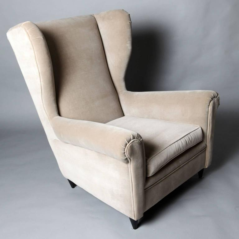 A pair of reupholstered armchairs in the style of Gio Ponti, circa 1950.