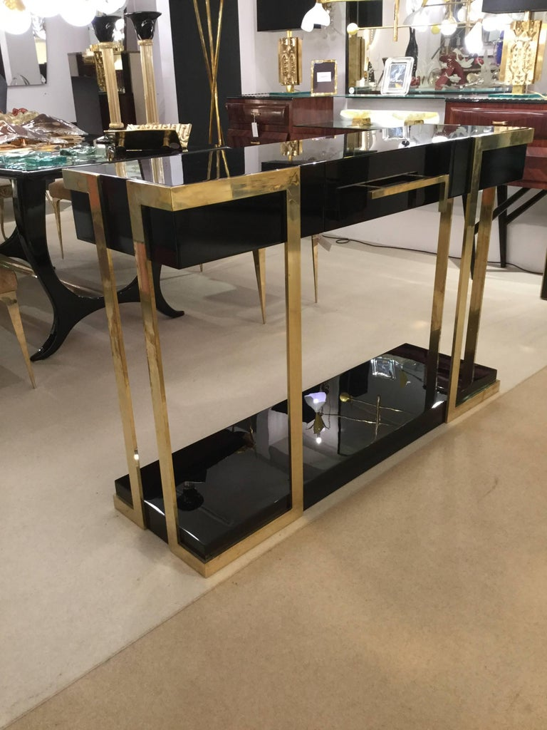Pair of Italian designed console tables in lacquered wood two drawers finished on the back with brass hardware