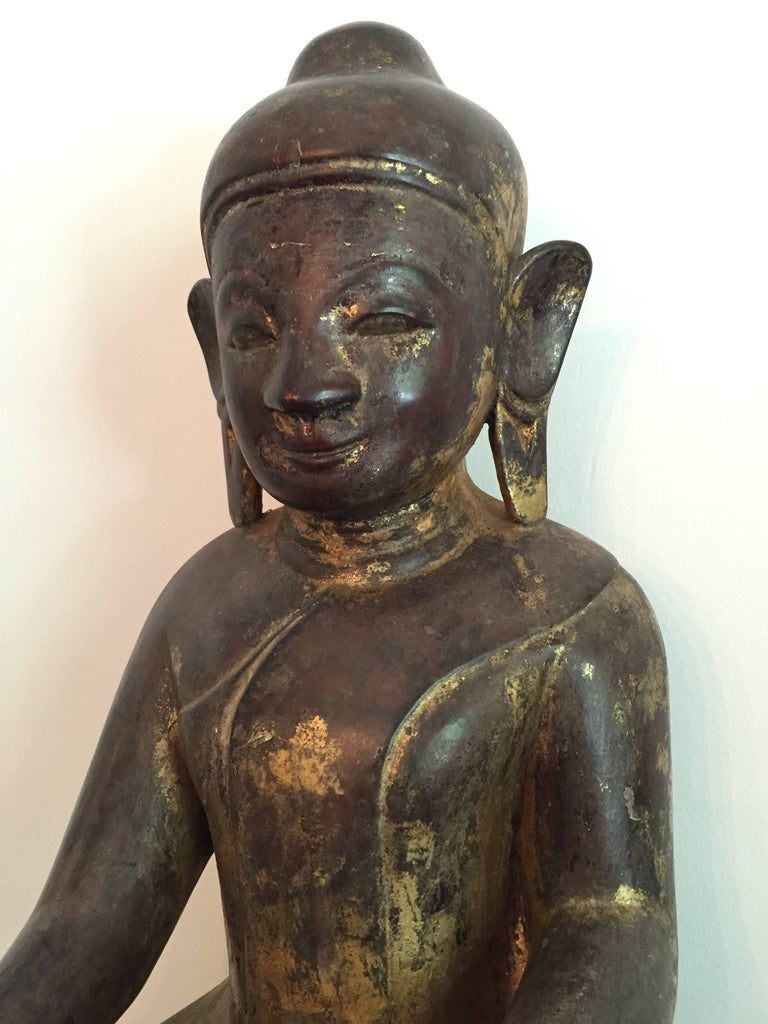 Wooden Burmese Buddha with traces of gold lacquer,