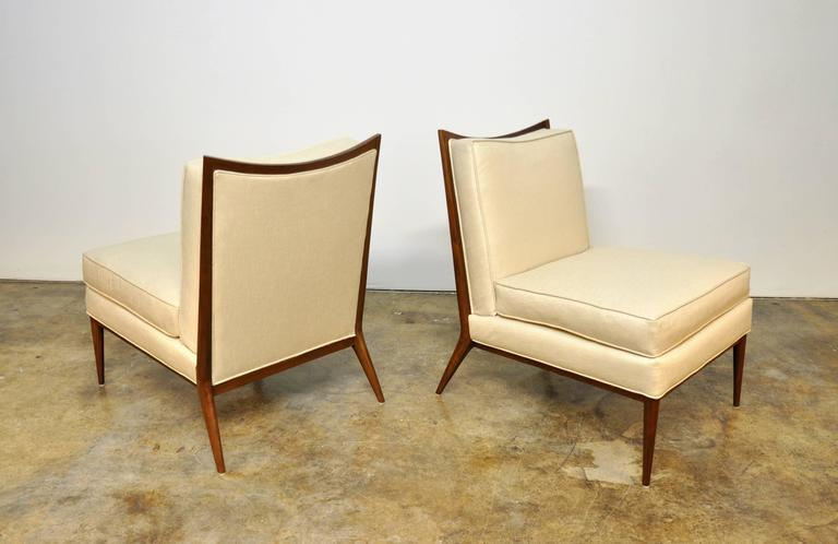 Exquisite pair of Mid-Century Modern slipper lounge chairs from the highly esteemed Directional collection, dating from the 1950s. The refinished chairs have been recovered in stunning soft champagne Kravet upholstery. The beautifully sculpted