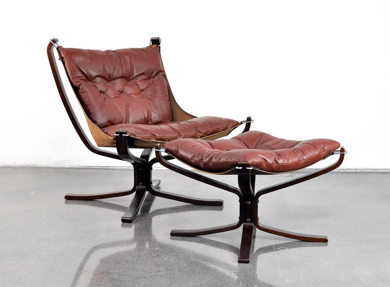 A Vintage Mid Century Danish Modern Leather Lounge Chair And Ottoman Designed In 1972