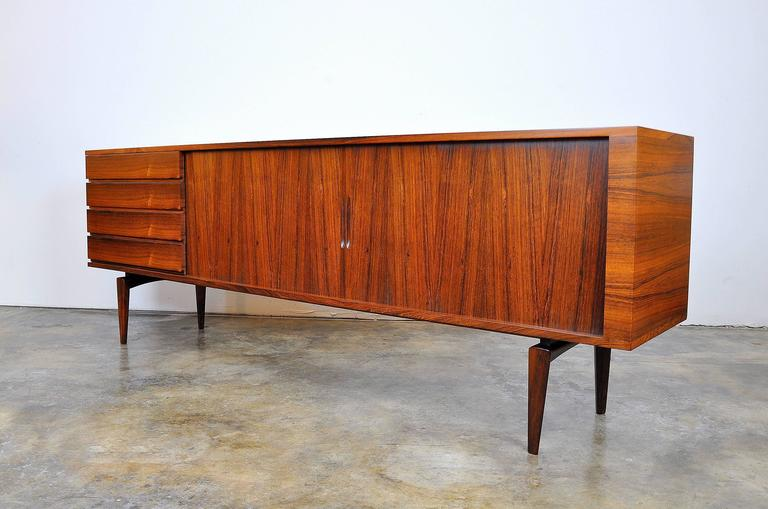 Outstanding Mid-Century Danish Modern sideboard designed by Scandinavian legend Henry Walter Klein for Bramin Mobler NA Jorgensens Mobelfabrik in the 1960s. This stunning buffet features a striking Silhouette very similar to the Presidential