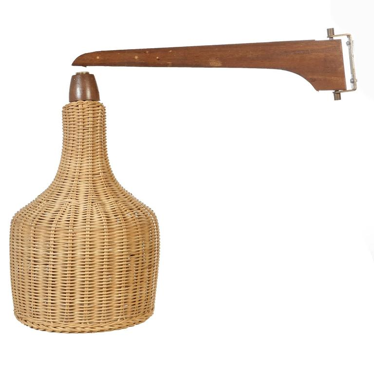 mid century wall mounted lamp with wicker shade at 1stdibs. Black Bedroom Furniture Sets. Home Design Ideas