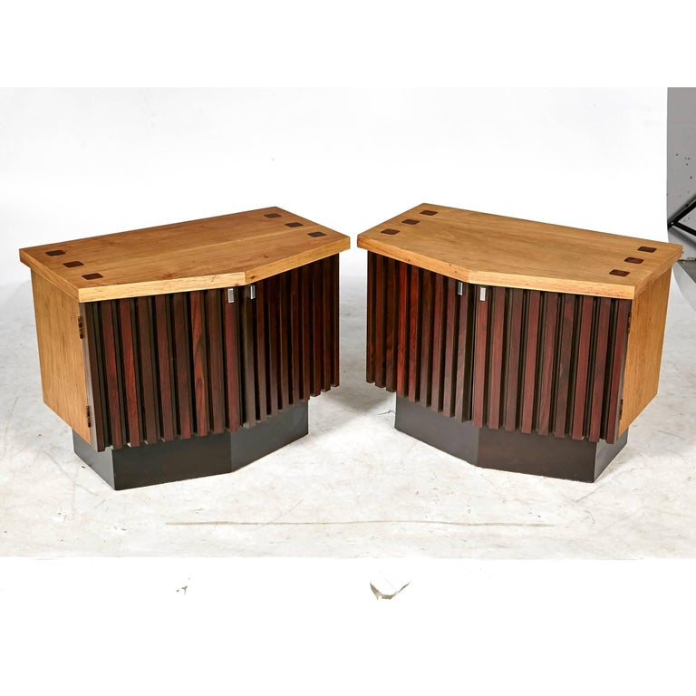 Vintage Mid-Century Modern walnut and rosewood accented pair of five-sided nightstands by Lane Furniture Co. The pair of nightstands has been refinished with a contrasting wood tone. The pair could also be used as side tables. The stands have metal