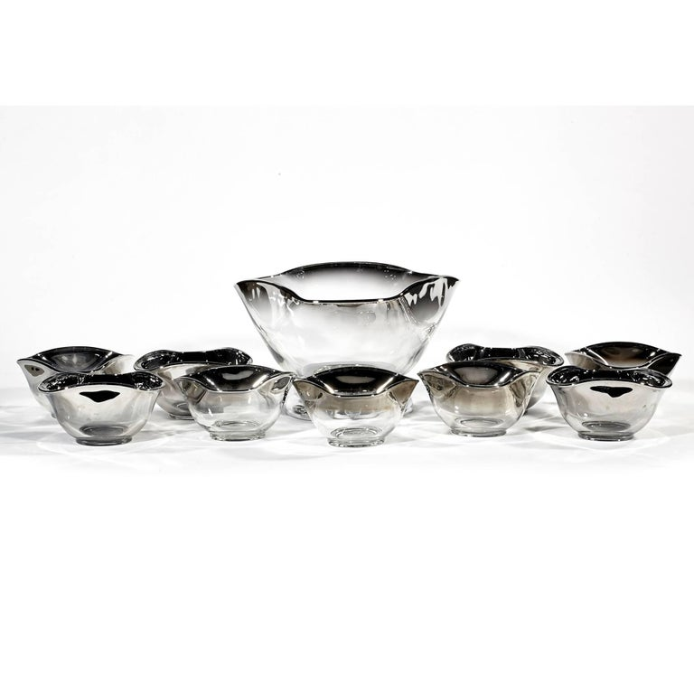 Vintage mid-20th century modern silver fade glass serving bowl set, circa 1960s. The set includes a large chrome base serving bowl and 9 individual bowls. Individual bowls are 5in.D x 3in.H.