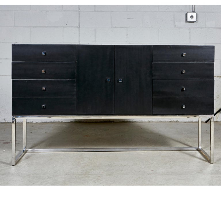 Vintage 1970s black painted credenza with a chrome base. The credenza has 8 drawers for storage and chrome pulls. In newly refinished condition. No maker's mark.