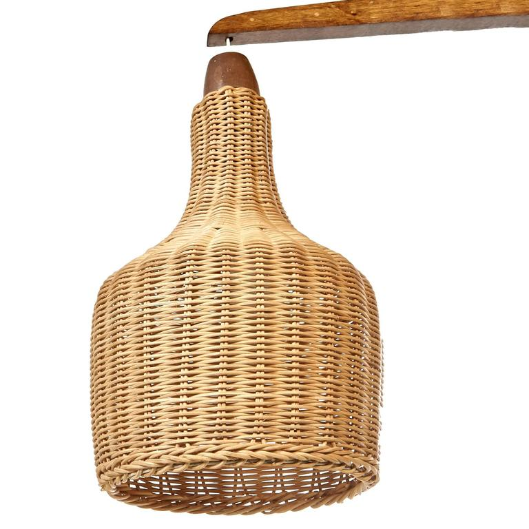 Mid-Century Wall-Mounted Lamp with Wicker Shade at 1stdibs