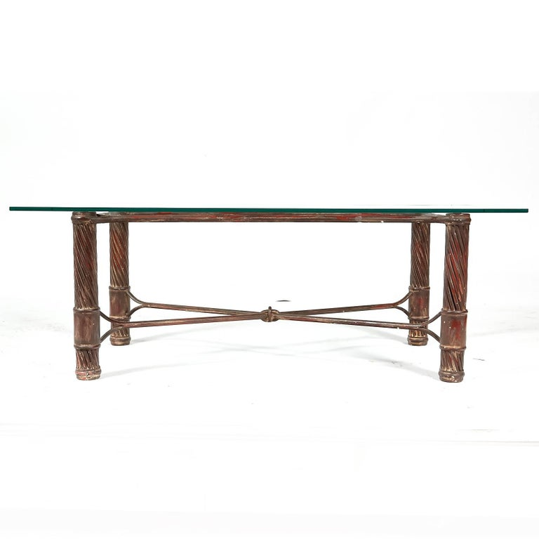 Vintage handmade iron base with a patina finish and rectangular glass top coffee table. Light wear to glass top from use. No maker's mark.
