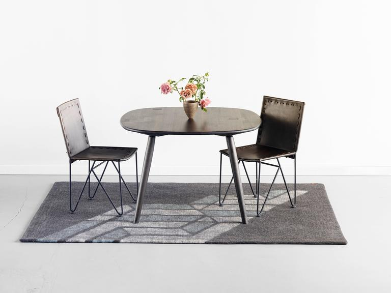 This small oxidized oak dining table from the Nomad Collection from Jacob May, exclusively at Heath Ceramics, is also available in two other finishes, natural walnut and natural oak.   The table proves that great design can be both clever and