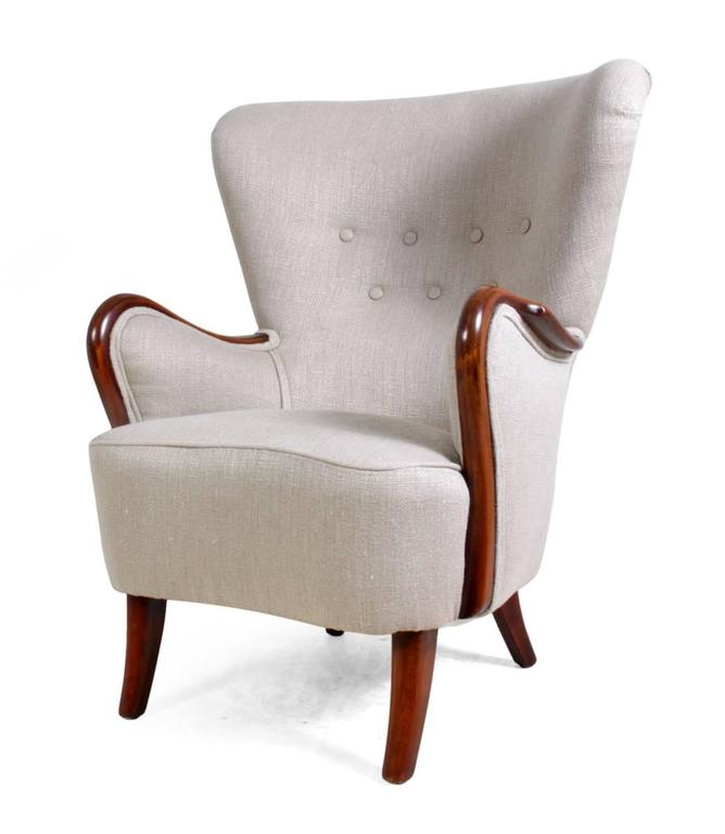 Danish armchair, circa 1940. An original 1940s, fully restored and upholstered Danish chair. Solid hardwood frame and a shaped back with buttoned detail. Age: 1940s. Style: Mid-Century. Material: Beech. Condition: Very good. Dimensions: 100H x