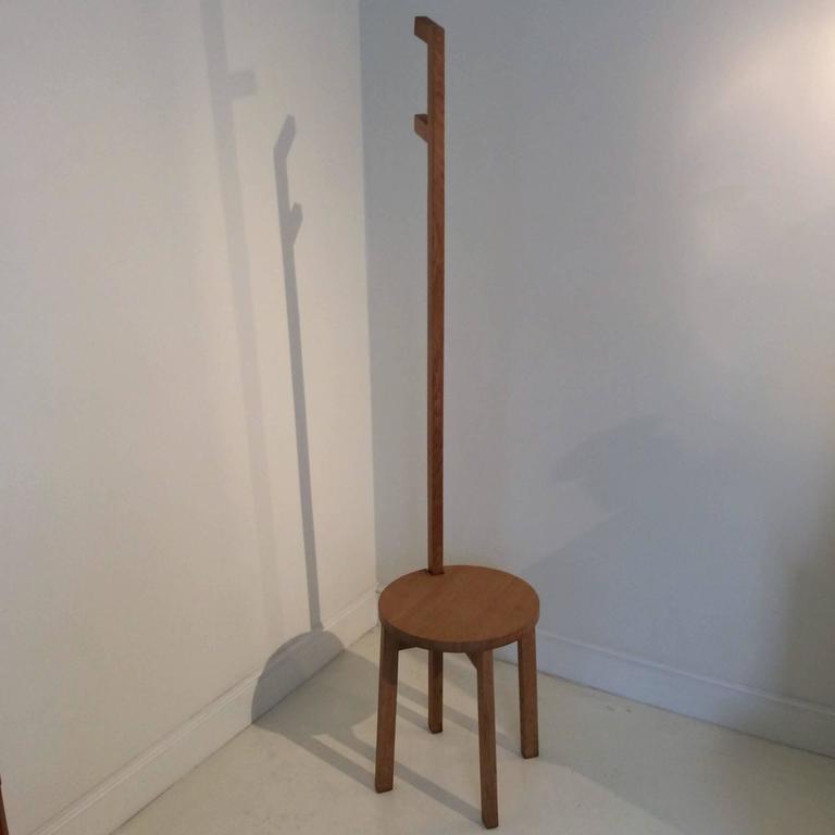 Marina Bautier, coat hanger-stool. Prototype designed in 2007, for Idee in Japan. Oak, round seat, four legs, one higher forming coat hanger. Measures: H 160 cm, diameter 35 cm. Exposed at the Tokyo Design Week in 2007. In 2014 Marina Bautier award