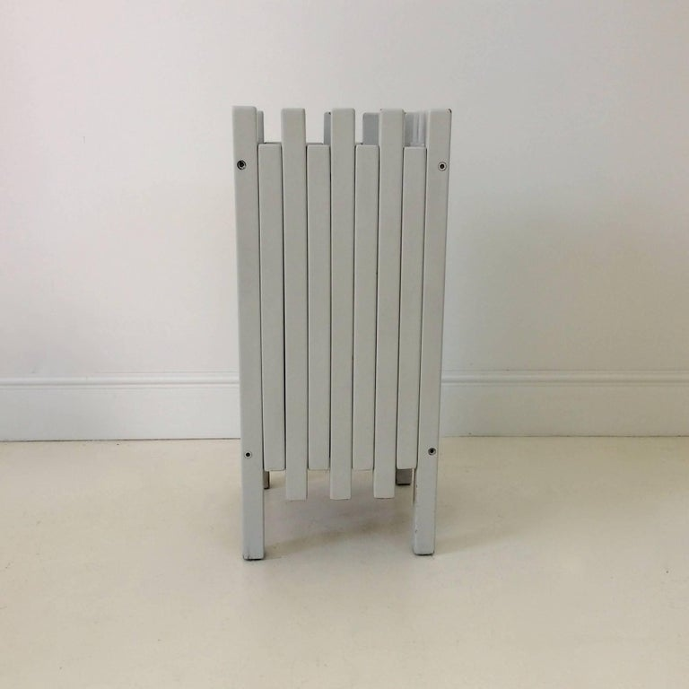 Ettore Sottsass umbrella holder for Poltronova, circa 1960, Italy. Light grey painted wood. Dimensions: 56 cm H, 25 cm W, 25 cm D. Good original vintage condition, wear consistent with age and use. We ship worldwide.