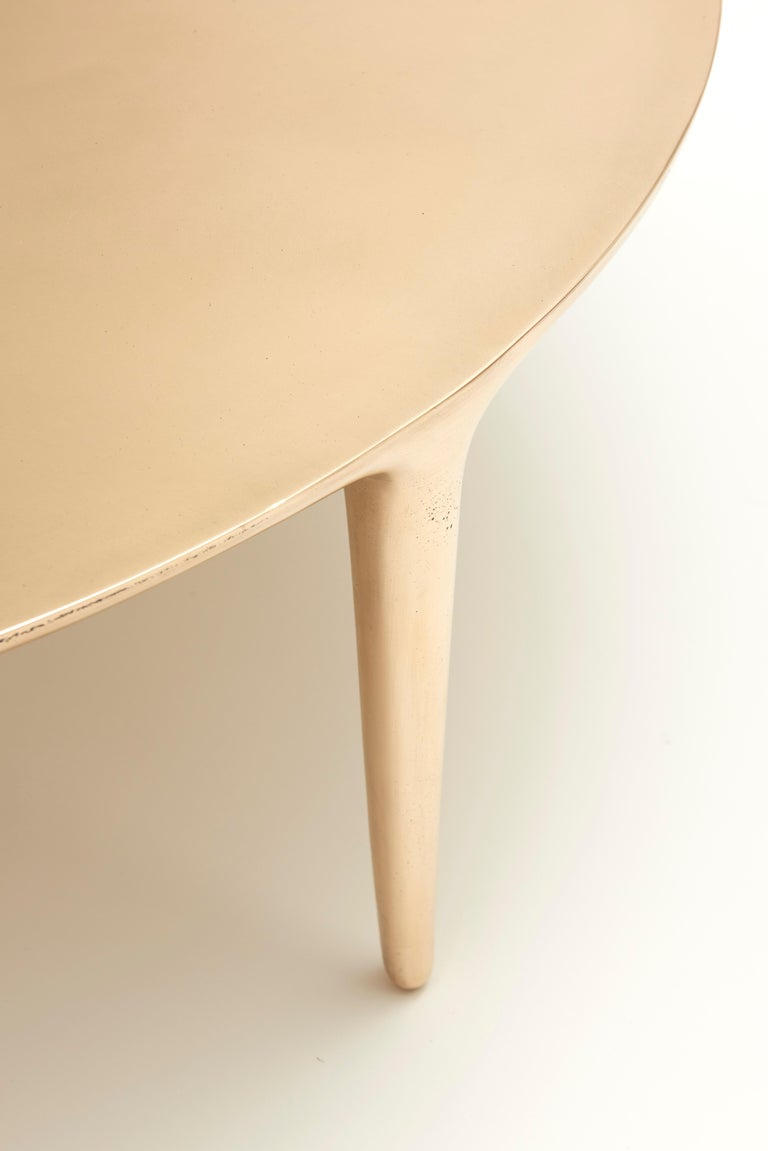 Large one-piece casting bronze tripod round coffee table.