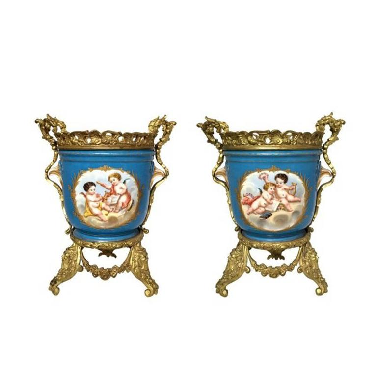 Attractive pair of 19th century French Sèvres style hand-painted porcelain ormolu-mounted planters.