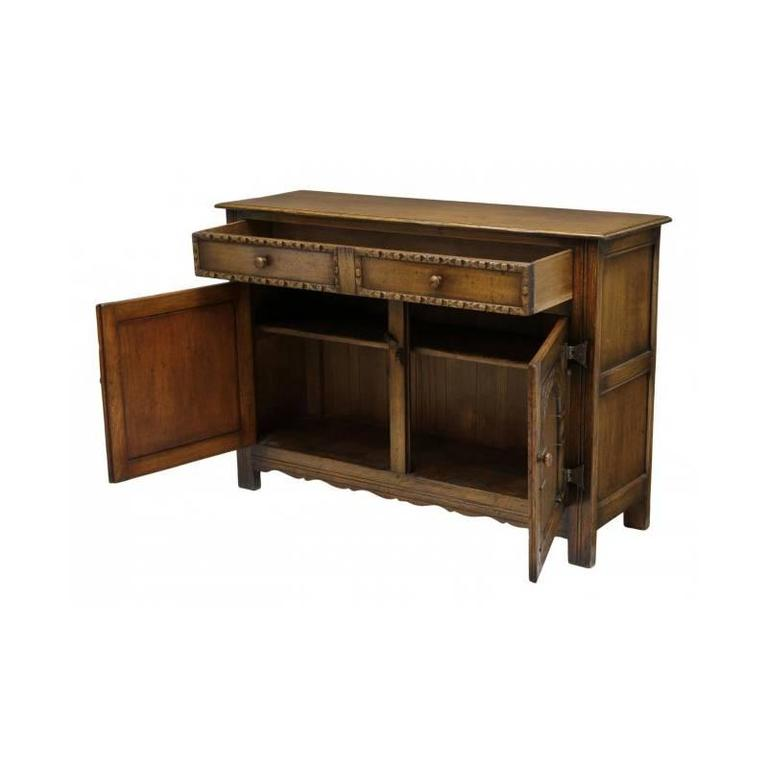20th Century Arts and Craft Style Carved Oak Two-Door Cabinet For Sale