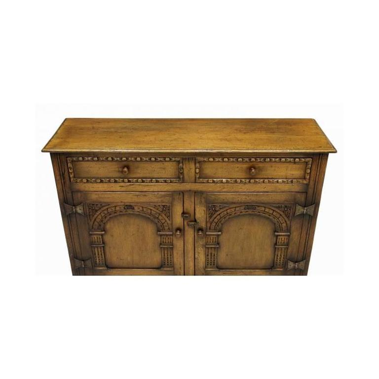 Arts and Crafts Arts and Craft Style Carved Oak Two-Door Cabinet For Sale