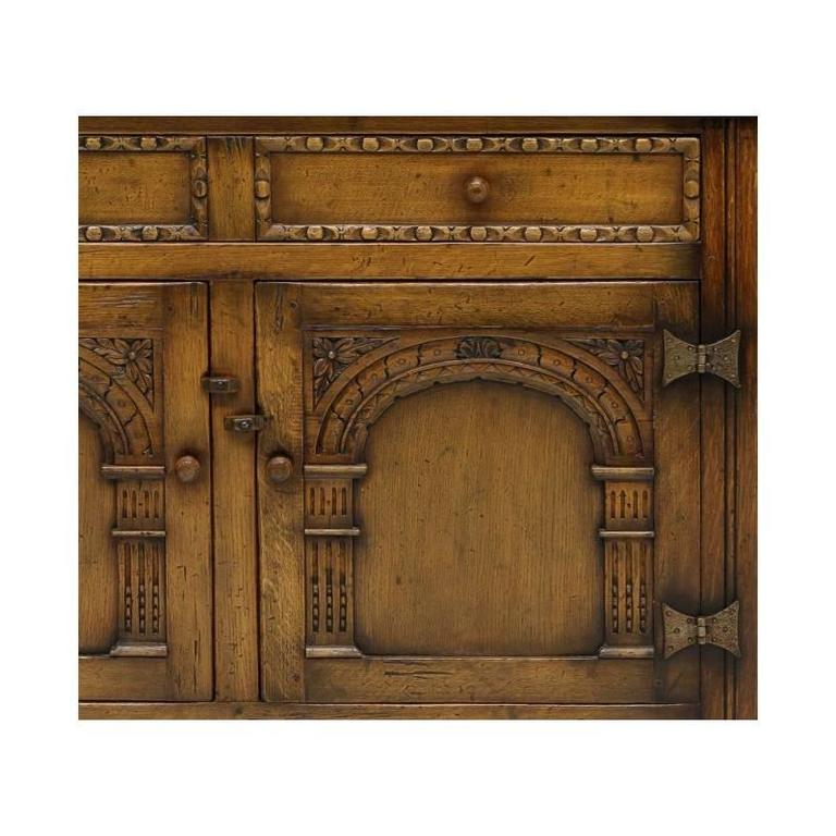 Arts and Craft Style Carved Oak Two-Door Cabinet In Good Condition For Sale In Cypress, CA
