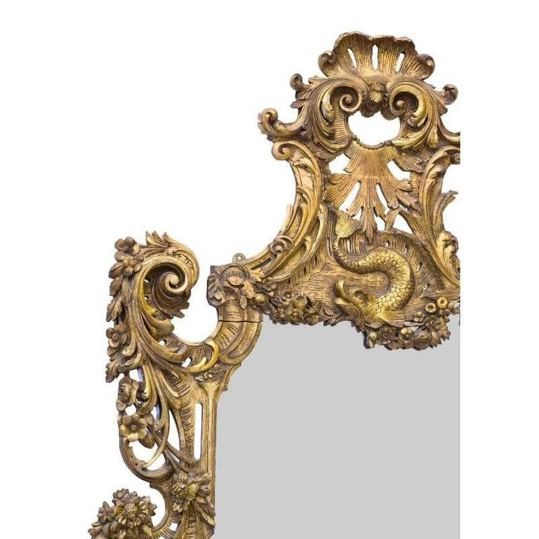 Imposing large mid-19th century Italian Baroque style carved giltwood mirror. The top is beautifully carved with a Rocaille motif with shell and centred by mystical dolphin. The sides are intricately decorated with scrolling acanthus and scrolled