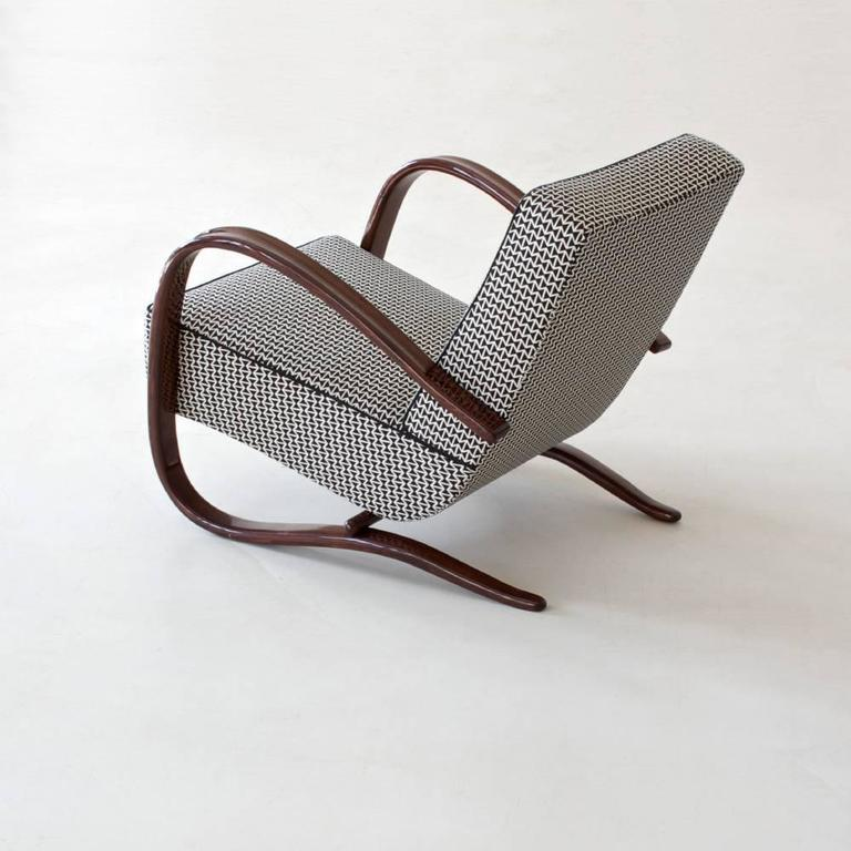Art Deco- Streamline Armchair designed by Jindrich Halabala and manufactured by UP Závody Brno, ca 1940.  This original Art Deco - Streamline Armchair is restored on request and available in different amounts. Delivery time between 6-8 weeks.
